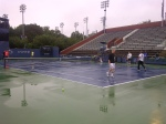 On my way to the indoor center for a warmup with Andy I passed by to find some juniors have a hit on wet courts and wet balls! They called it dedication I call it desperation and not to smart! Injury's around the corner!